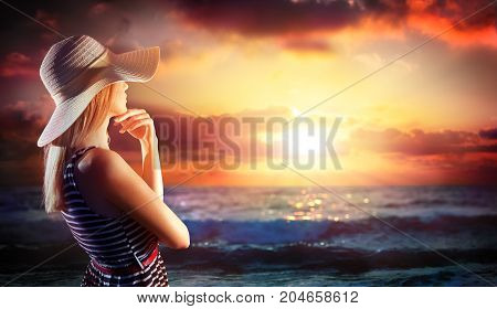 woman looking in sunset on the sea - summer holidays