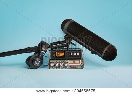 equipment for field audio recording on blue background