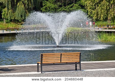 Fountain in the park and a bench
