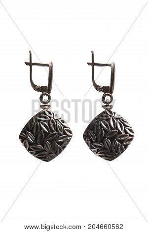 Elegant vintage bronze earrings on white background