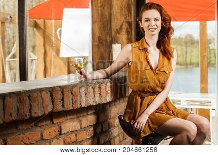 Beautiful Lonely Woman In Dress With Glass Of Wine.
