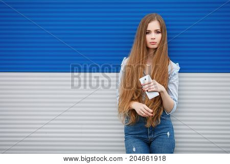 Emotional Portrait Of A Adult Pretty Blonde Woman With Gorgeous Extra Long Hair Posing Outdoors Agai