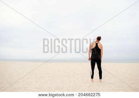 Man Is Doing Exercises On The Sea In The Early Morning.