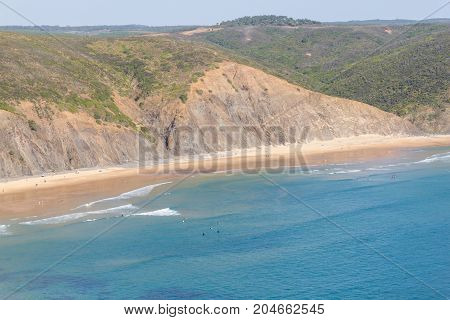 Cliffs, Beach And Waves In Arrifana