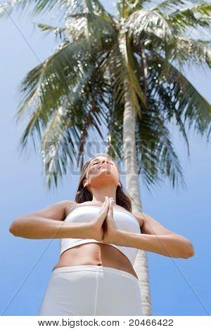 view on slim woman doing yoga