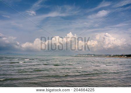Albania. Golem. Seascape of the Adriatic Sea with cumulus clouds.