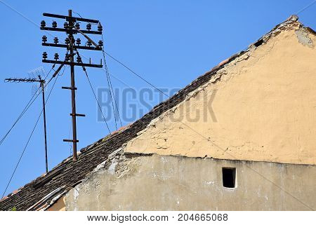 Old style telephone lines on the top of a building