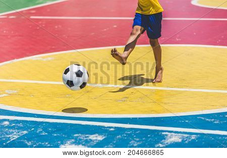 Soccer player / Little boy training soccer in the gymnasium.
