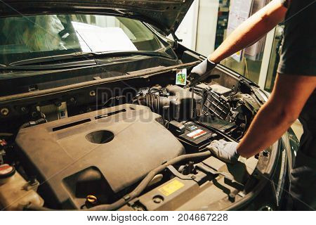Car engine repair. An auto mechanic fixing an engine