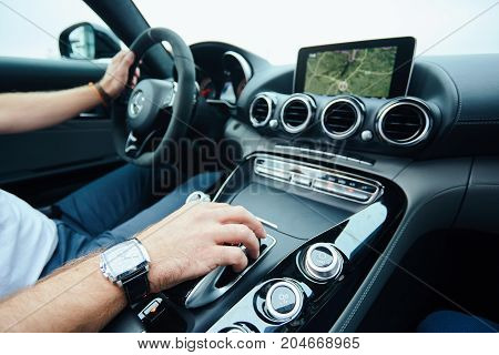 hand on automatic gear shift, Man hand shifting an automatic car.