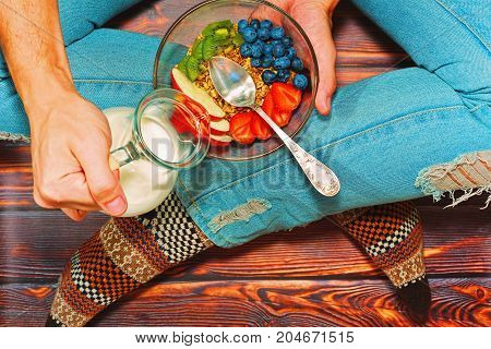 Person Having Healthy Breakfast On Wooden Floor