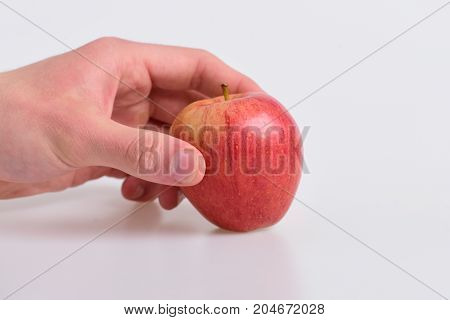 Food And Healthy Lifestyle Concept. Male Hand Holds Red Apple