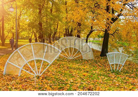 ST PETERSBURG RUSSIA-OCTOBER 3 2016. Glass composition Fans of the Empress in the autumn park of Michael Garden in St Petersburg Russia. St Petersburg Russia autumn view