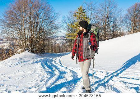 Bearded Male Hiker On A Snowy Mountain