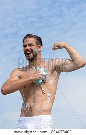 Man With Bristle Laughing And Showing Muscles