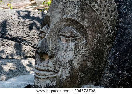 Close up of Buddha head on stone