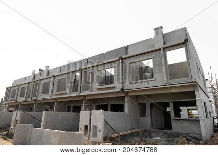 Row of Townhouse prefabricated building isolated on white background.