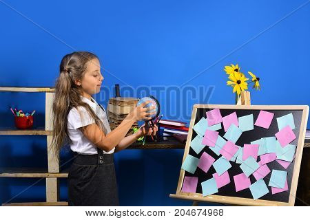 Girl Stands By Blackboard With Colored Sticky Notes