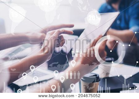 Concept of digital diagram, graph interfaces, virtual screen, connections icon on blurred background.Business meeting process.Female hand pointing to touch tablet screen.Horizontal