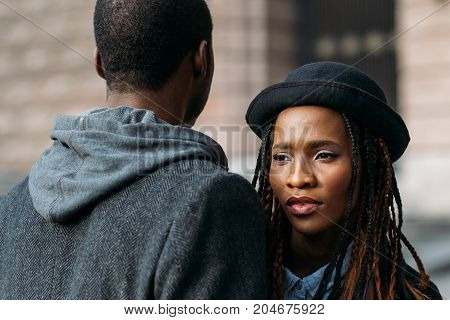 Strong love connection. African American couple. Young fashionable people, unrecognizable black male, stylish concept