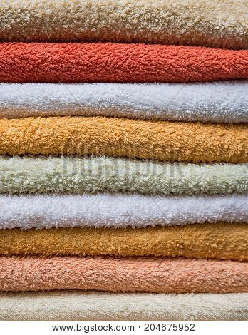 Stack Of Bath Towels In Orange And Beige Colors