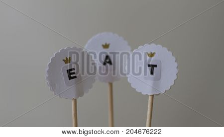 Toppers for cake decoration on neutral background