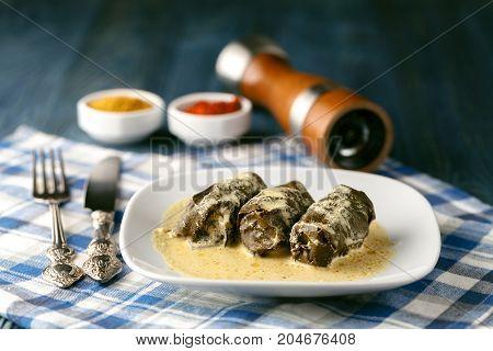 Georgian Cuisine Dolma On Plate With Souce