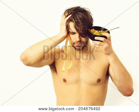 Caucasian Macho Holding Black Bowl With Pasta And Measuring Tape
