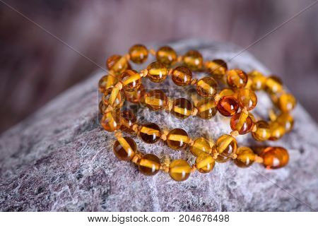 Amber Beads Accessory Isolated On Stone Background