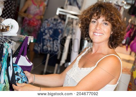 Women Are Choosing A Dress In Clothing Shop