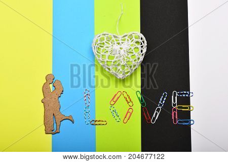 White Crochet Heart And Paper Clips Making Word Love