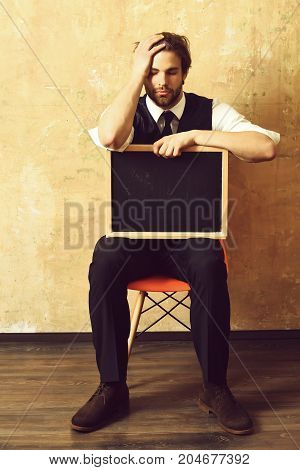 Student Or Tired Businessman Holding A Blackboard