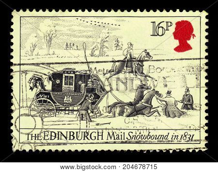 UNITED KINGDOM - CIRCA 1984: A stamp printed in UK shows portrait of Elizabeth II and mail coach stuck in the snow, inscriptions the Edinburgh Mail snowbound in 1831, series postal service Bath-London, circa 1984