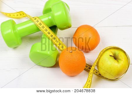 Training Concept, Dumbbells Weight With Measuring Tape ,fruit