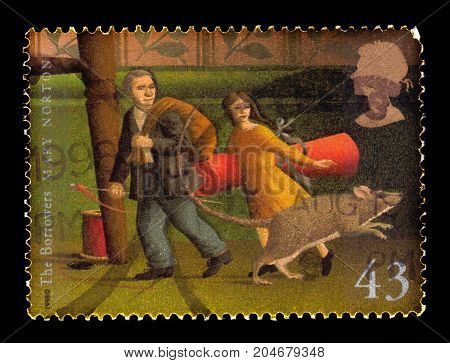 UNITED KINGDOM - CIRCA 1998: A stamp printed in Great Britain shows  illustration for the book the Borrowers, novel by english author Mary Norton, published by Dent in 1952, circa 1998