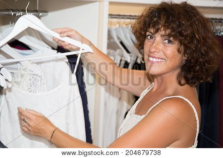 a beautiful woman shopping in clothing store