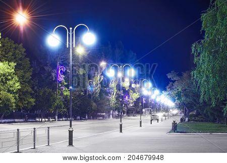 A lightened City street at night. Pokrov town, Ukraine