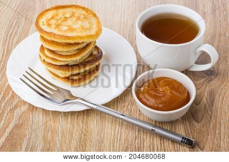 Stack Of Pancakes In Plate, Fork, Bowl With Apricot Jam