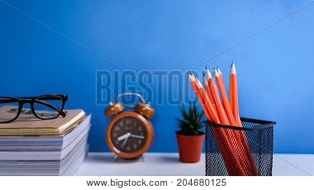 Books Pencil And Glasses On A White Wooden Table Are Clocks And Decorations