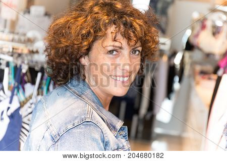 Beautiful Woman Shopping Trendy Clothes In Shop