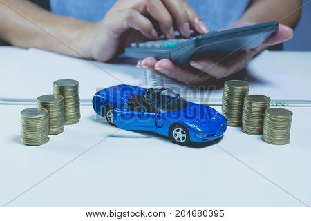 Car insurance with stack coins and car services concept. Business concept. Car insurance concept.