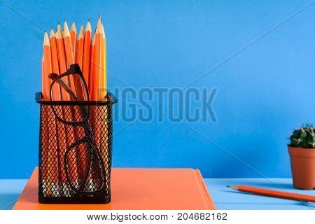 Books Pencil And Glasses On A Blue Wooden Table