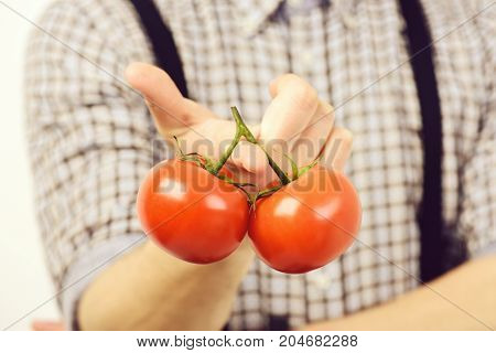 Slim Shape And Healthy Diet Concept. Man Holds Red Tomatoes