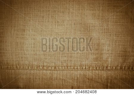Texture of linen fabric in beige color throughout the plane of the frame