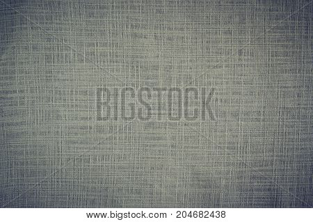 Texture of a linen cloth of gray color on all plane of a frame