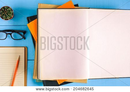 Top View Book Mockup And Pencil Note On Blue Wood Table