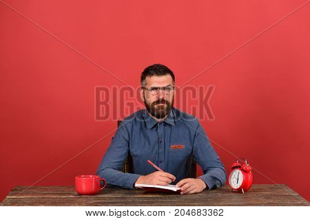 Cup, Retro Clock And Red Book On Vintage Table
