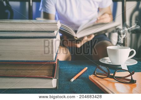 Men Read Book On Table In The House