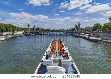 Tourist Boat On River Seine By  Pont Alexandre Iii In Paris, France