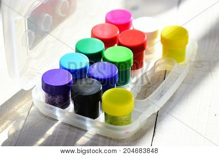 Bottles Of Gouache With Glitters In Transparent Box